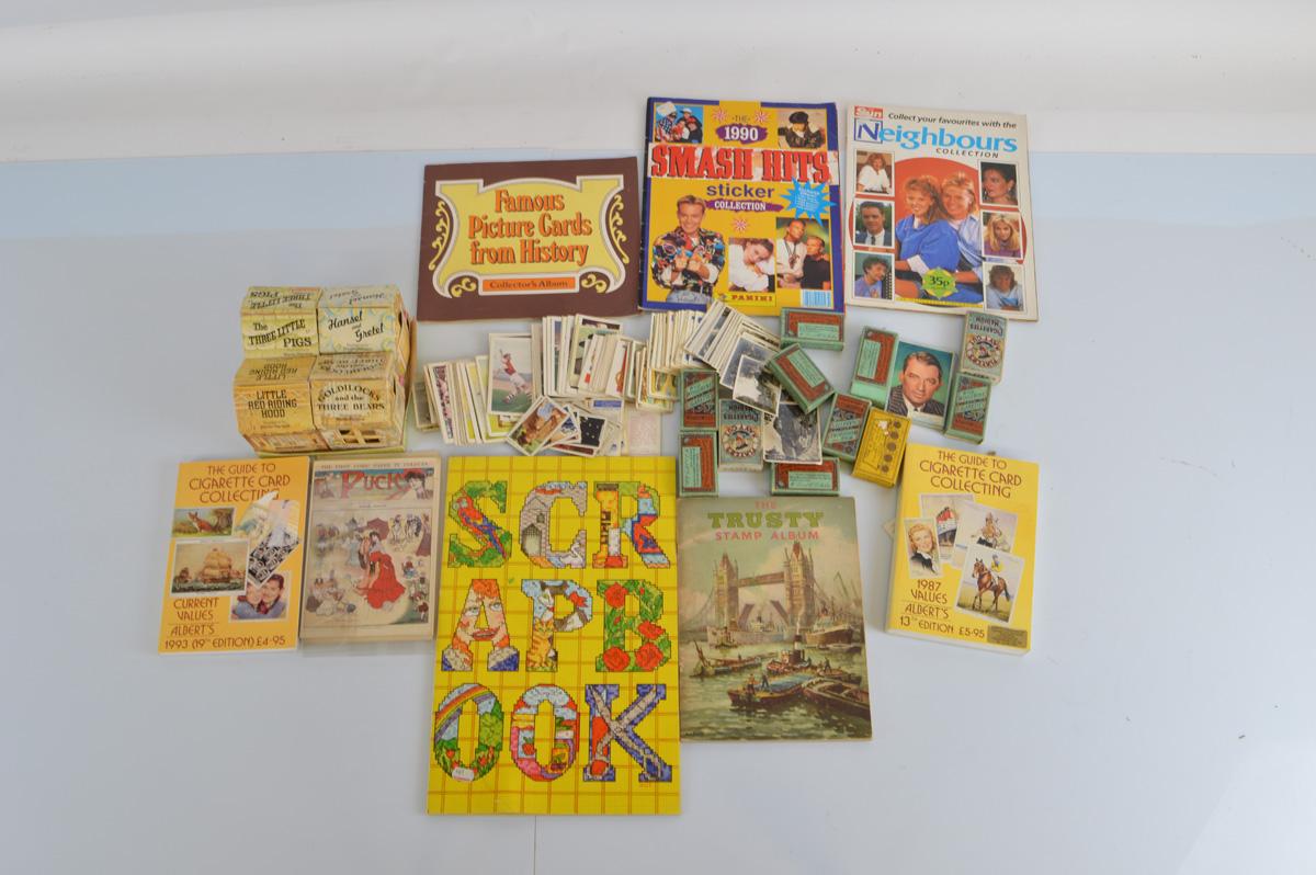 A mixed lot of ephemera, including cigarette and tea cards, stamp album etc