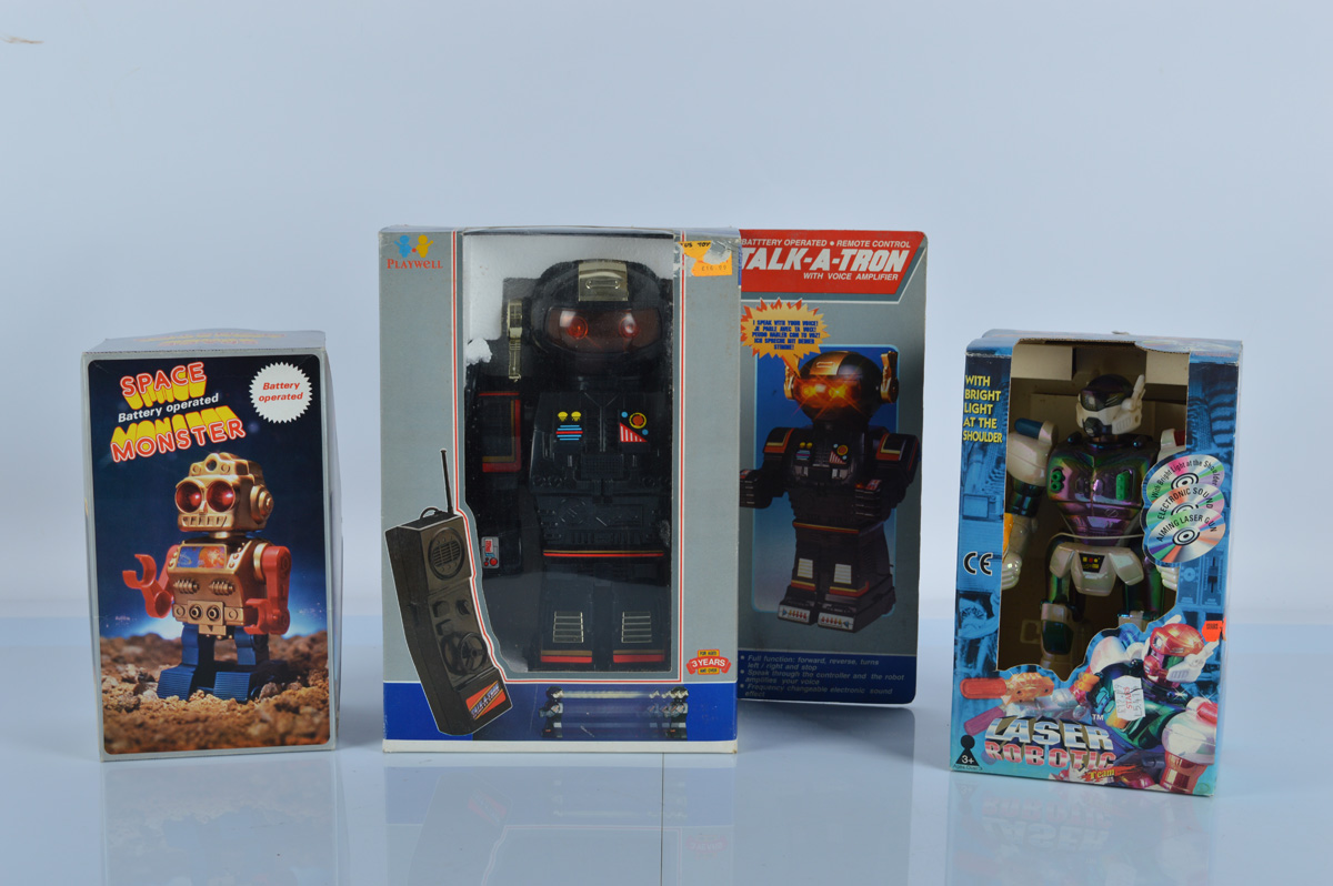 Three vintage battery operated Robot toys, Playwell Talk-a-Tron, Hap-P-Kid Laser Robotic Team and