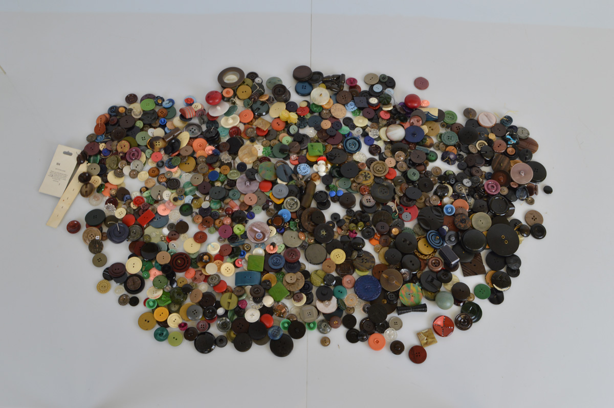 A collection of early to mid 20th century buttons, various styles, shapes and materials.