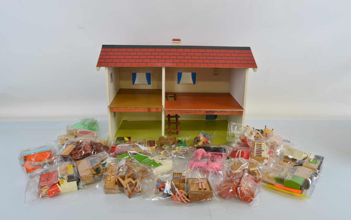 A large dolls house, together with a quantity of assorted dolls house furniture and accessories