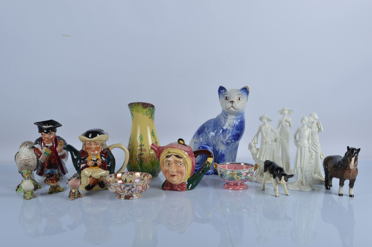 A collection of English ceramics, including Beswick Birds and Animals, a large Arthur Wood blue