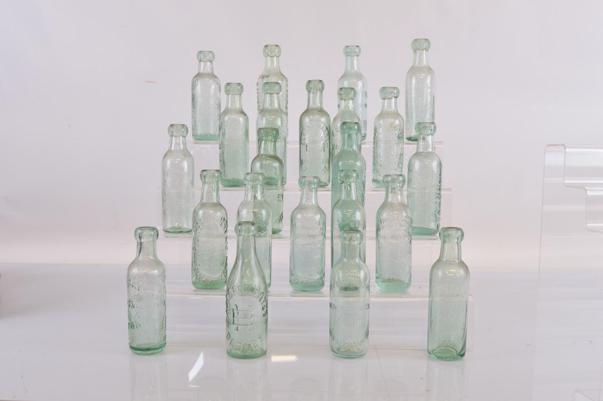 A collection of twenty three flat bottomed beer bottles, by various makers from Dudley,