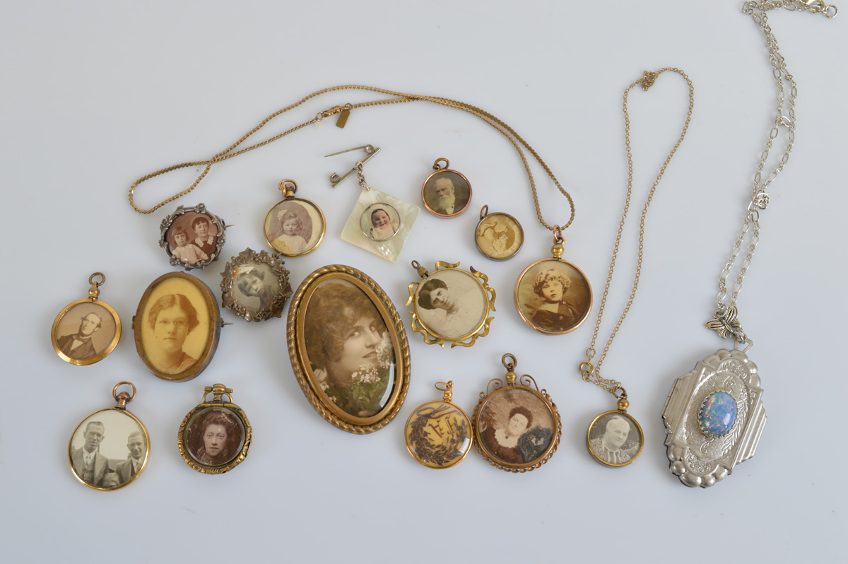 A collection of lockets, mostly open circular design, including an Arts and Crafts example, with
