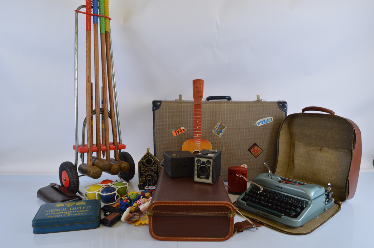 A mixed lot of toys and collectables, including a vintage croquet set, Imperial typewriter, two