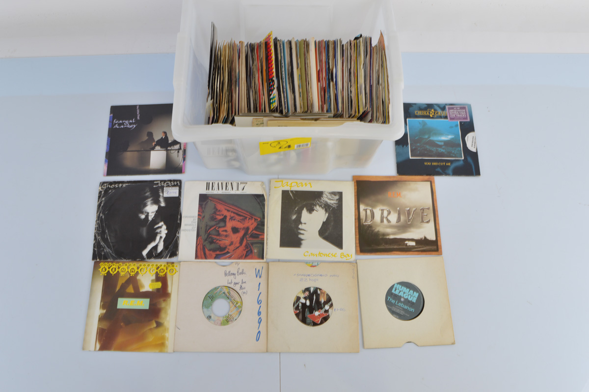A mixed lot including, vinyl record singles with artists including Phil Collins, REM, Feargal