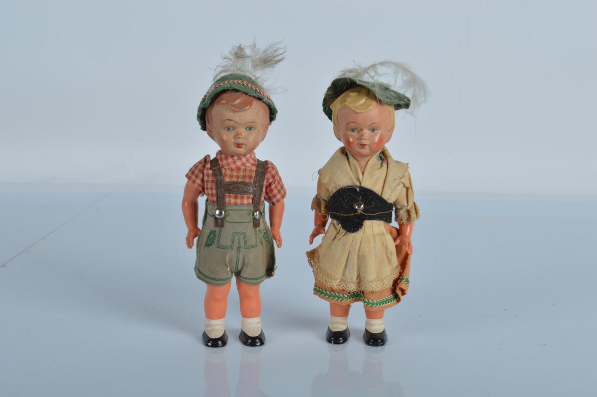 Two German Schildkrot plastic clockwork dolls, both wearing traditional German clothing. 17cm tall