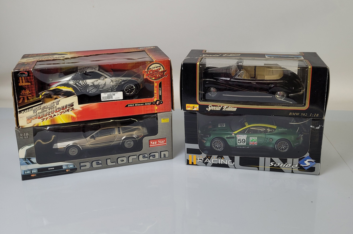 Four 1:18 scale diecast models, comprising an RC2 Fast and Furious Nissan 350Z, Sun Satr DeLorean,