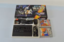 An Atari 2600 Console, together with Spider-man and The Empire Strikes Back games and a Star Wars