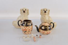 A pair of 19th century Staffordshire dogs, with moulded coats and glass eyes 25cm tall. Together