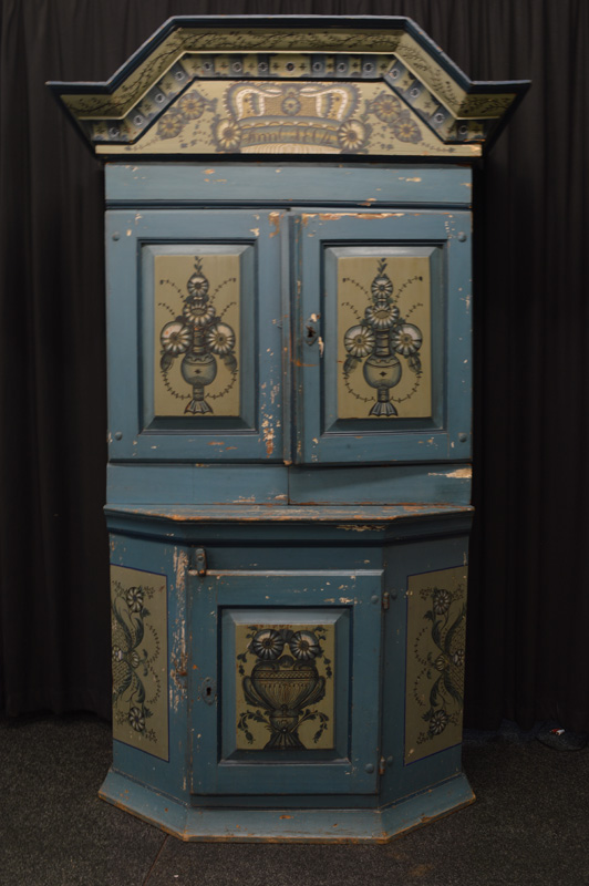 A Swedish pine painted kitchen cabinet, with panelled double door, having floral spray decoration to