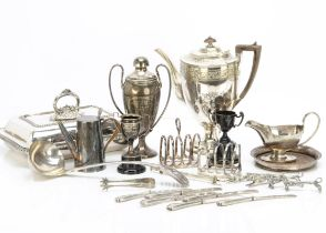 A collection of silver plate, including five butter knives with silver handles, a soup ladle, a