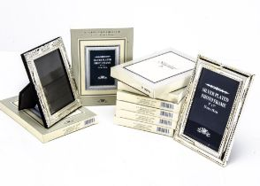 A collection of thirty three modern silver plated photograph frames, each boxed, 19 with internal
