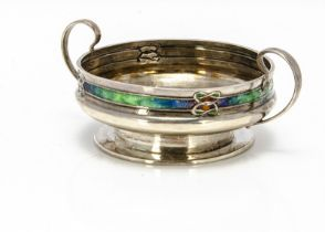 An Edwardian Arts & Crafts silver and enamelled twin handled footed small bowl from Liberty & Co,