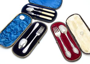 Three Victorian Christening sets in cases, with two spoon and fork sets, and one three piece set (