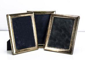 A set of three modern silver mounted photograph frames, 22.2cm high (3)