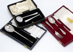 A 1960s silver feeding set, in case, together with a cased silver christening spoon and fork set and