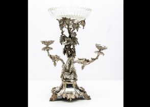 A Victorian silver plated centrepiece, having three inserted branch candle holders and all decorated