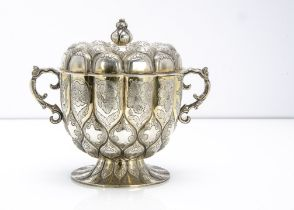A George V silver twin handled cup and cover from Mappin & Webb, the lobed shaped footed base with