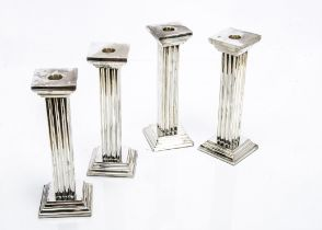 A set of four modern silver plated candlesticks, 23cm high of squared column form (4)