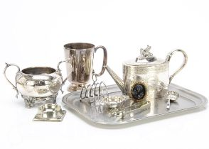 A 1930s silver tea strainer, together with a group of silver plated items and a black glass cameo
