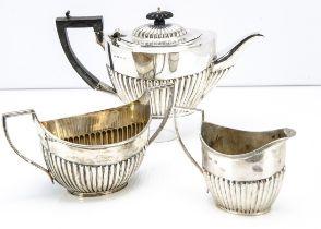 An Edwardian and later associated three piece tea set, with teapot, large sugar basin and milk
