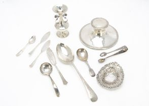 An Edwardian silver filled capstan inkwell and other silver and white metal items, including a