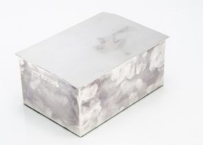 A modern silver cigarette box from Aquascutum, loose lid with dented corner, 15cm wide, on