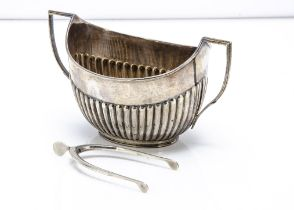 A late Victorian silver sugar basin by William Hutton & Sons, together with a pair of wishbone
