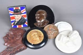 A group of six Winston Churchill wall plaques/hangers, together with an Adolf Hitler example (7)