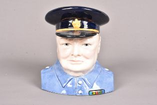 A Carlton Ware Winston Churchill 'Prototype' character jug, with black cap with blue shirt, marked