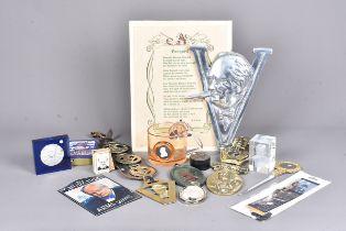An assortment of Churchill related items, to include brass door knocker, badges, coins, cufflinks,