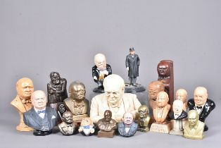 A collection of Churchill busts and figures, including a carved wooden example, with marks to the