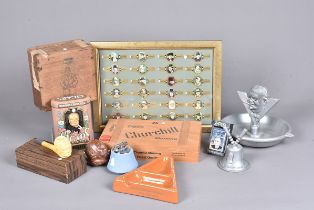 A collection of Winston Churchill related smoking items, to include a 1991 Zippo, cigar boxes, a