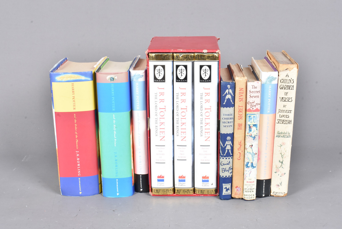 J.R.R. Tolkein, three volumes of Lord of the Rings, The Fellowship of the Ring, The Two Towers and
