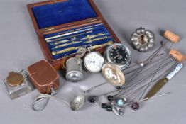 A Smiths M1 8Day car clock, marked 2474 to reverse, together with a selection of hat pins, a Liga