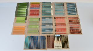 A collection of graphite pencils, mostly sharpened to points, including Faber Castell Gilbert, Eagle