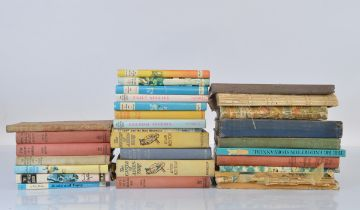 A collection of Enid Blyton books, all hardback examples, some with dust jackets. Together with