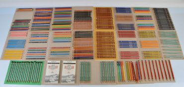 A collection of graphite pencils, mostly sharpened to points, including Cumberland Five Star,