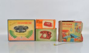 A boxed, hard to find, Tri-ang Telephone in green, VG in G/G+ attractively illustrated box