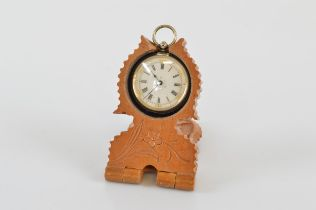A Continental white metal ladies fob watch, case stamped 0,800. With white enamel dial with Roman