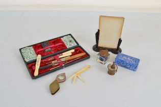 A small mixed lot of collectables, including a Bakelite picture frame, glass bodied inkwell, bone
