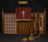 A cast iron and painted oak Preacher's lectern and screen, with repeating floral and scroll grill
