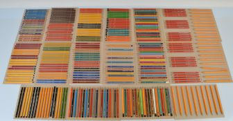 A collection of graphite pencils, mostly sharpened to points, including Eagle Cardinal, Berol