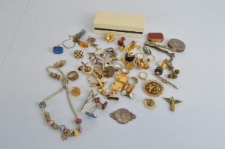 A collection of costume jewellery, including silver gilt gem set cluster ring, gold shell buckle