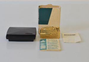 A 9ct gold Ronson lighter, having textured design to body, in box and card case with papers,