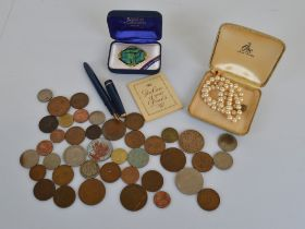 A small collection of British and World coinage, together with a string of Ciro pearls in box, a
