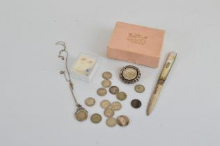A small collection of silver, including a hallmarked silver Mop handled fruit knife and pin