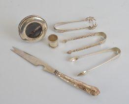 A pair of Elizabeth II coronation duty marked sugar tongs, by Wakely & Wheeler circa 1952,