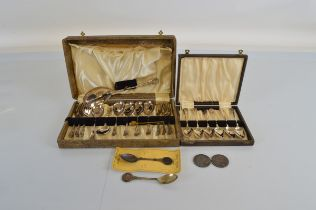 Two Victorian silver crowns, 1895 and 1887. Together with two boxed sets of silver plated spoons.