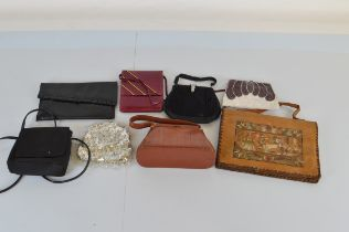 A collection of ladies handbags, including a snakeskin example with purse on safety chain, evening